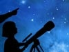 image of child with telescope looking at the night sky