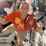 photo of an orange and a football in space